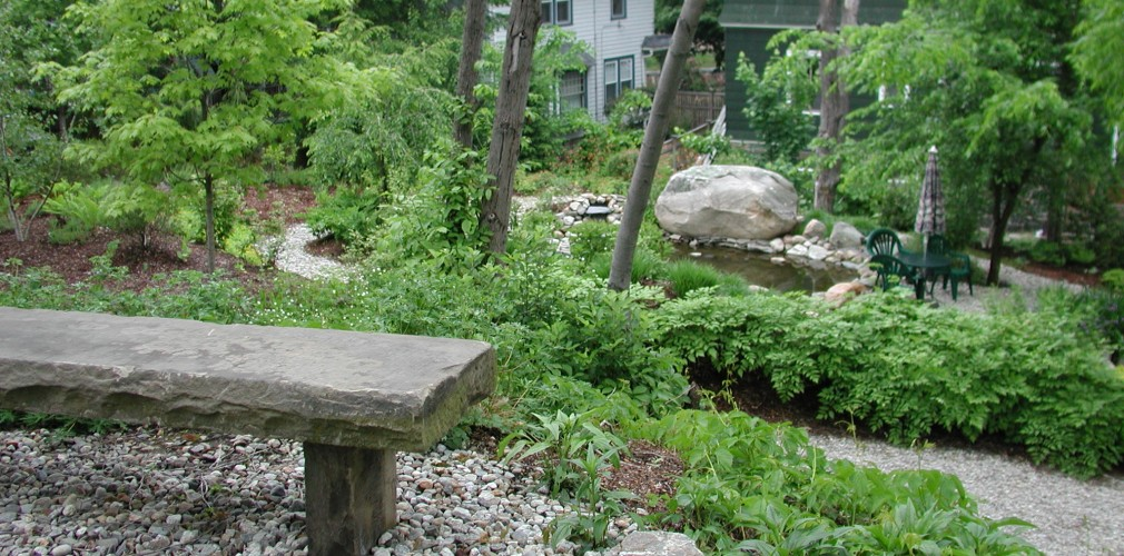Design For This Urban Oasis Site Focused Around Two Created Ponds And Working With The Site's Considerable Topography.  Path To Top Of Rise Is Rewarded By Stone Bench Destination Affording View To Upper Pond And Large Boulder.